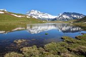 VANOISE, FRANCE: View of four summits (Rechasse, Grande Casse, Grande Motte and Pierre Brune) from a lake in Northern Alps poster