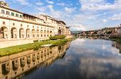 Vasari Corridor and reflaction on the Arno river poster