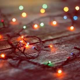 Christmas lights on a wooden background .