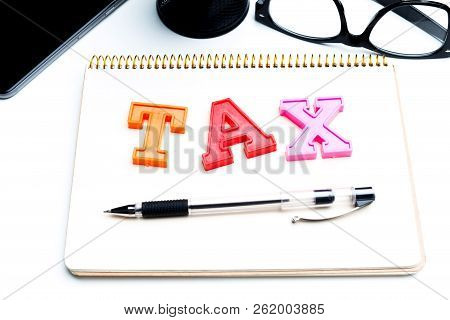 Blank Note Paper With Tax. Close Up. Object. Macro Photography