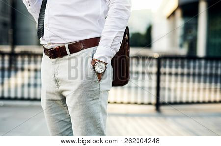 Unrecognizable Businessman With Watch Standing On The Street In City.