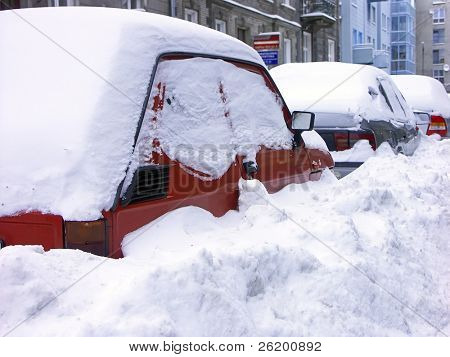 Row of cars stuck in heavy snowbank
