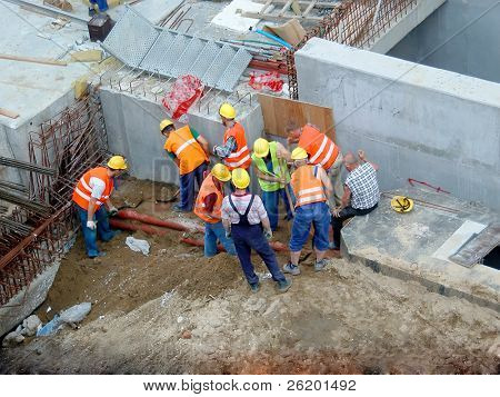 Group of construction workers working together
