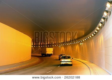 Row of vehicles moving through the tunnel
