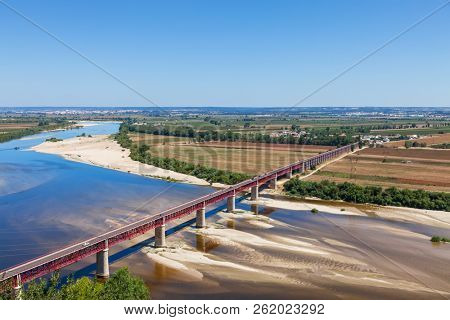 Santarem, Portugal. Ponte Dom Luis I Bridge, Tagus River and Leziria fields the fertile alluvial plain of Ribatejo,. Seen from Portas do Sol viewpoint poster