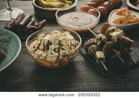 Mixed Tapas Or Antipasti Appetizers On Old Wooden Table. New Years Eve Party. Vintage Effect