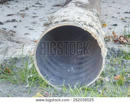 Long metal industrial pipes laying on ground. Repairing of the water delivery system. Open trench with water pipe and heap of ground near. poster