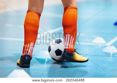 Futsal League. Indoor Soccer Player In Futsal Shoes Training Dribble Drill With Ball. Indoor Soccer