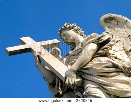 Statue of an angel holding a cross outside of Castel Sant'Angelo in Rome Italy. poster
