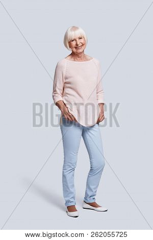 Just Be Happy! Full Length Of Beautiful Senior Woman Looking At Camera And Smiling While Standing Ag