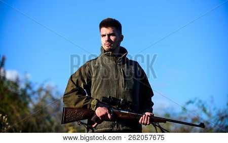 Masculine leisure activity. Guy hunting nature environment. Man bearded hunter rifle nature background. Hunting hobby concept. Hunting season. Experience and practice lends success hunting poster