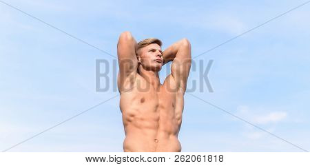 Sexy torso attractive body. Strong muscles emphasize masculinity sexuality. Man muscular chest naked torso stand sky background. Man muscular athlete bodybuilder show muscles. Bodybuilder shape poster