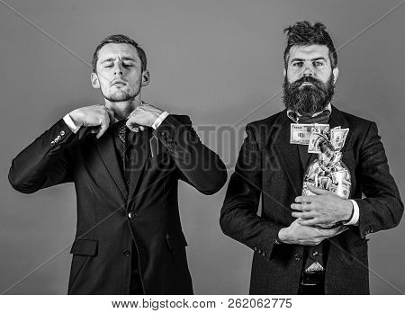 Crediting Concept. Men In Suit, Businessmen With Jar Full Of Cash And Credit Card, Blue Background.