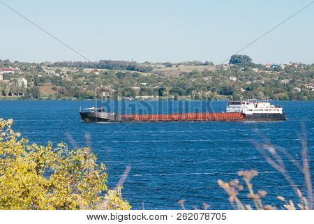 Old Barge On The River. Barge Floats On The Dnieper River. Barge With Cargo Floating On The River On