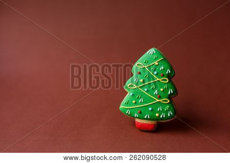 Christmas Holiday Sweets. Christmas Holiday Traditions. Christmas Tree Gingerbread On Dark Red Backg