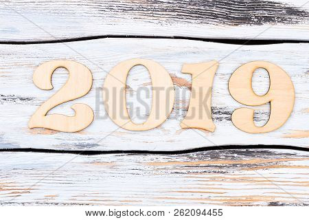 Wooden Number 2019 On Wooden Background. Cutout Wooden Digits Forming Number Of New Year 2019 On Whi