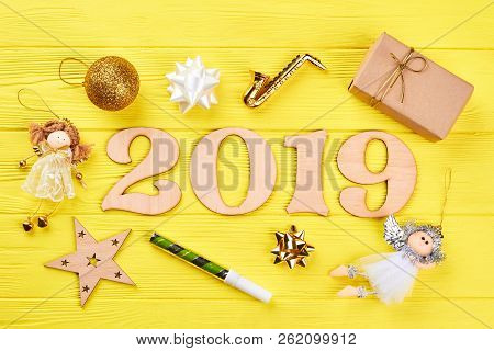 Wooden Number 2019 And Christmas Ornaments. Wooden Numbers Forming The Number 2019 For The New Year