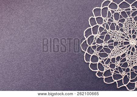 Beautiful Crochet Delicate Openwork Vintage Background Of Napkin On The Dark Felt Canvas. Lace Vinta