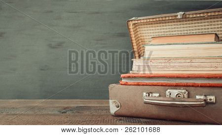 Vintage Old Classic Travel Leather Suitcases With Stack Of Old Books And Albums. Travel Luggage Conc