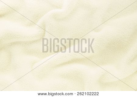 Fluffy Gentle Baby Beige Cream Fabric With Waves And Folds. Soft Pastel Textile Texture. Folds On Th