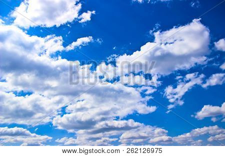 Background Of Blue Sky With White Clouds And A Lot Of Casting Birds