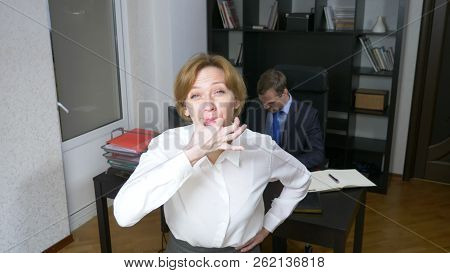 Humor, Irony. A Woman In The Office Whistles, Alerting Workers. Business Concept.
