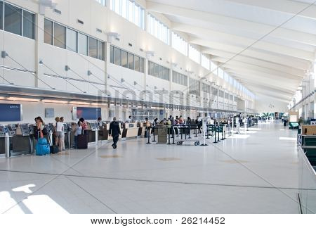 Airport terminal and concourse with travelers and passengers