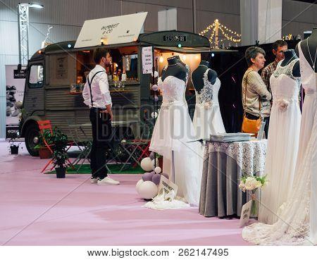 Paris, France - Oct 6, 2018: Wedding Exhibition Paris 2018 With People -customers Admiring Dresses N