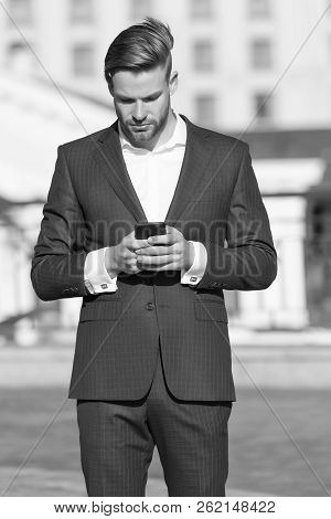 Message Concept. Man In Suit Businessman Takes Advantages Of Modern Mobile Technologies. Man Reads M
