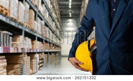 Business Logistics Concept, Double Exposure Of Engineer Or Worker Hold Yellow Helmet For Workers Sec