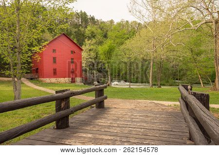Red Mill Barn At The End Of A Wooden Bridge, Old Grist Mill, Farm Community