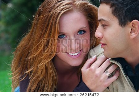 Young couple in an autumn forest picnic area