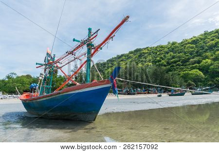Blue Fishing Boat On Sea Sand With Green Hill And Other Boat Of Fisherman At Khao Kalok Beach Thaila