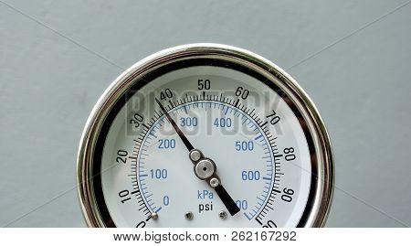 Closeup Of Manometer, Measuring Gas Pressure. Pipes And Valves At Industrial Plant.pressure Gauge, M