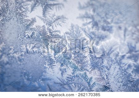 Winter Ice Pattern On The Frozen Window. Texture, Background For Inserting Text. New Year Theme. Win