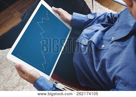 A Man Working On Digital Tablet, Business Raising Graph On Screen. Success Investment And Business G