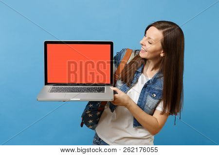 Young Pleasant Woman Student With Backpack Holding And Looking On Laptop Pc Computer With Blank Blac