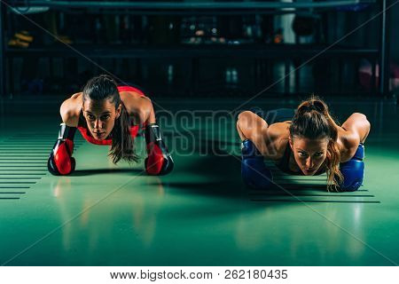 Women On Boxing Training Doing Push Ups