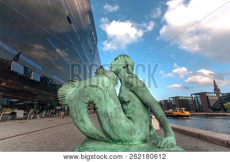 Copenhagen, Denmark - Sept 6: Mermaid Bronze Sculpture Made In 1921, Stand Between Royal Danish Libr
