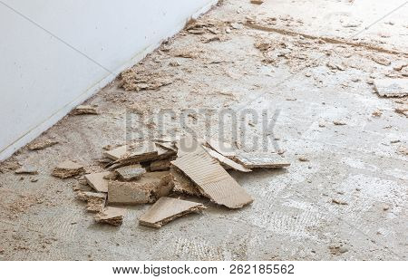 Construction concept - Jackhammer, removing chipboard from the floor - Selective focus poster