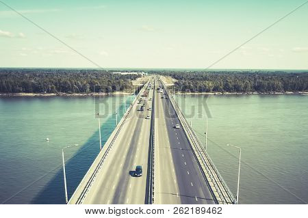 A View To The Well-consrtucted City Bridge Across The River. City River Gates. Cars On The Bridge Mo