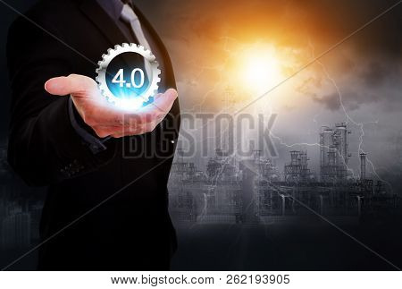 Industrial 4.0 Cyber Physical Systems Concept, Gears Industry4.0 Icons On Business Hand With Oil Ref
