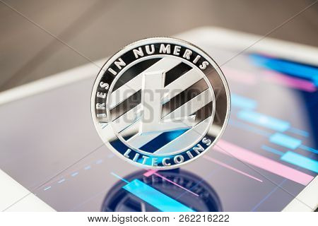 Close-up Photo Of Litecoin Cryptocurrency. Litecoin Physical Coin On The Tablet Computer. Tablet Sho