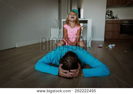 Difficult Parenting- Father Is Tired Exhausted While Daughter Makes Noise