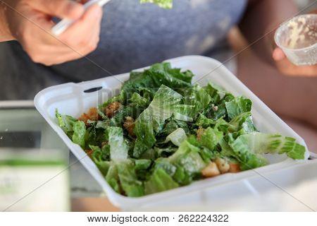 Eating green salad
