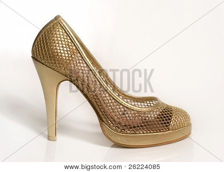 an elegant gold shoe on high heel separated on white background
