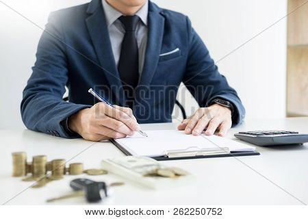 Businessman Giving End Key To Customer After Good Deal Agreement. While Loan Agreement Being Approve