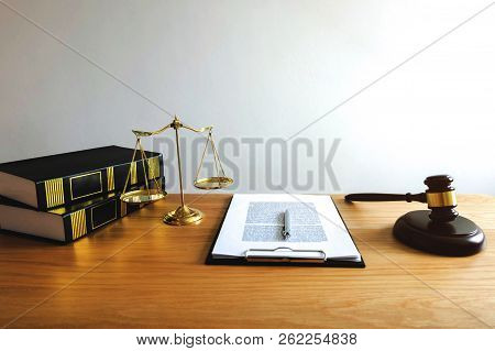 Close Up Object  Law Concept. Judge Gavel With Justice Lawyers And Documents Working On Table.