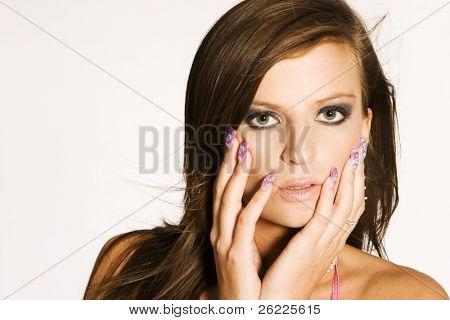 portrait beautiful brunette woman in light background