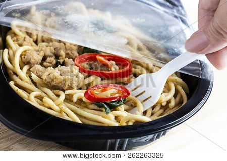 Take-away Food Ready Meal: Woman Hands Holding Fork And Open Cling Wrap With Take Out Food In Plasti